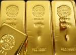 PRECIOUS-Gold gains as poor euro zone data stokes risk-off sentiment