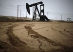 Oil hits 1-week high ahead of U.S. supply data; Libyan output in focus