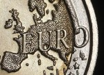 FOREX-Dollar edges up on euro woes, capped by White House drama