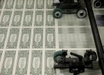 Dollar pushes higher vs. rivals in subdued trade