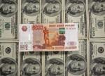 Рубль стабилен в условиях укрепления доллара, дорогой нефти и налоговых выплат