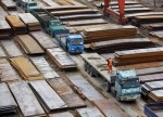 UPDATE 1-Australia clears iron ore ports, miners brace as cyclones approach