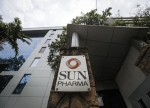 UPDATE 1-Indian drugmaker Sun Pharma swings to surprise quarterly loss