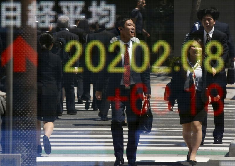 Asian Stocks Up, Amid Warnings About Stock Bubbles