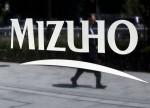 BOJ should tread carefully when deliberating deeper cuts, Mizuho Bank head says
