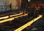 UPDATE 1-China steel hits near 1-month low on demand woes, drags iron ore