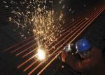 Crescimento indústria transformadora China desacelera em junho com aumento das tensões comerciais