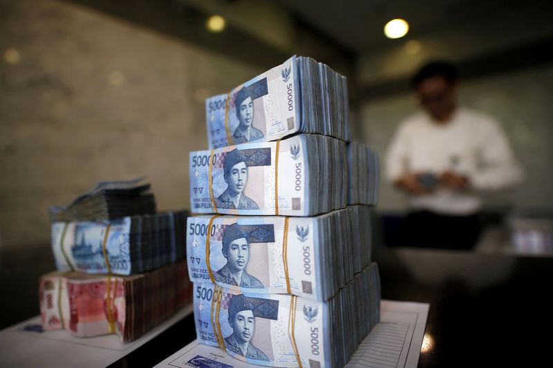 © Reuters.  Indonesia Cuts Key Rate Again, Says Future Moves Depend on Data