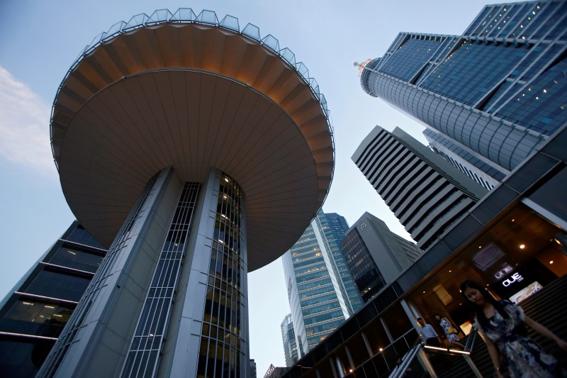© Reuters.  Singapore Still Competitive Despite Higher Taxes, Minister Says