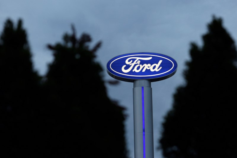 BRIEF-Ford Says Lowering FY Company Adjusted. EBIT Outlook By Reuters