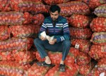 UPDATE 1-India's retail inflation eases in December, within RBI target