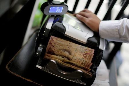 Exclusive: Venezuela taps small banks to handle dollar deals