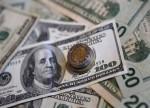 MONEDAS A.LATINA-Peso mexicano mira señales para política monetaria; real brasileño volátil