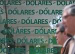 CÂMBIO-Dólar tem leve oscilação ante real com exterior e correção