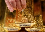 PRECIOUS-Gold slips as dollar firms on speculation over Fed chief