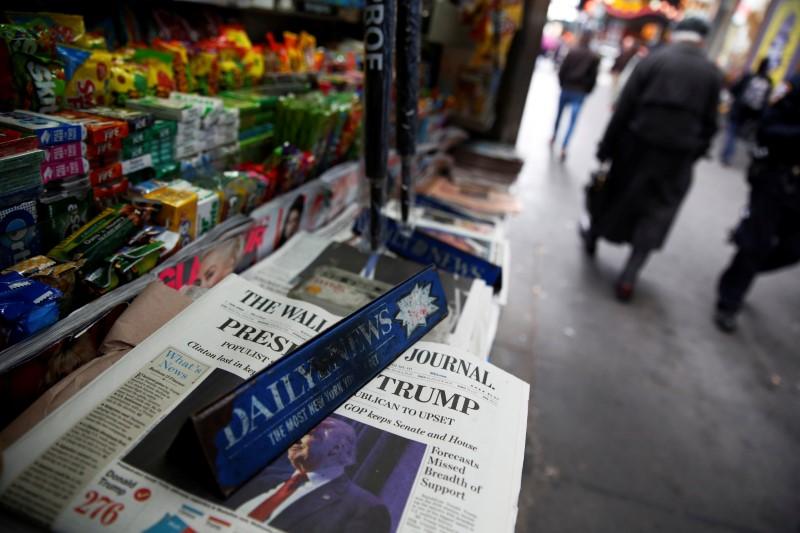 © Reuters.  Эксперты снижают прогнозы роста американской экономики из-за разочарований в политике Трампа