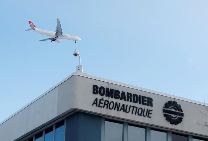 © Reuters.  UPDATE 5-Bombardier to cut 5,000 jobs, sell units; share dive on cash flow worries