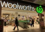 UPDATE 3-Australia's property downturn puts Woolworths' shoppers off their champagne