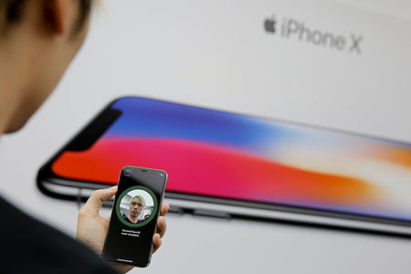 UPDATE 1-India raises import tax on cellphones, move to hurt Apple