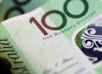 Australia dollar underwhelmed by wage data, awaits Fed