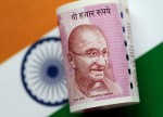 UPDATE 1-Indian rupee, bonds surge on lower oil prices, cenbank announcement