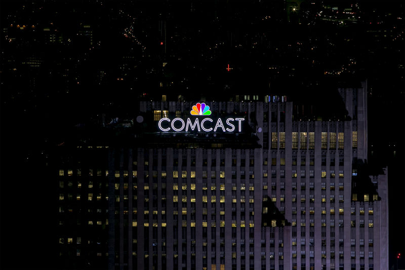 © Reuters.  Comcast makes higher offer for Sky, tops Fox bid
