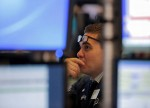 Wall Street hit by weak industrial earnings, hawkish Fed