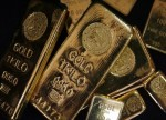CORRECTED-PRECIOUS-Gold prices slip but hold above $1,300