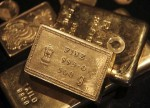PRECIOUS-Gold hits year low as dollar steadies ahead of Fed testimony