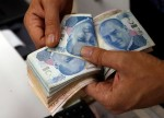 Turkey Targets Credit as Sanctions, Rating Spark Lira Jitters
