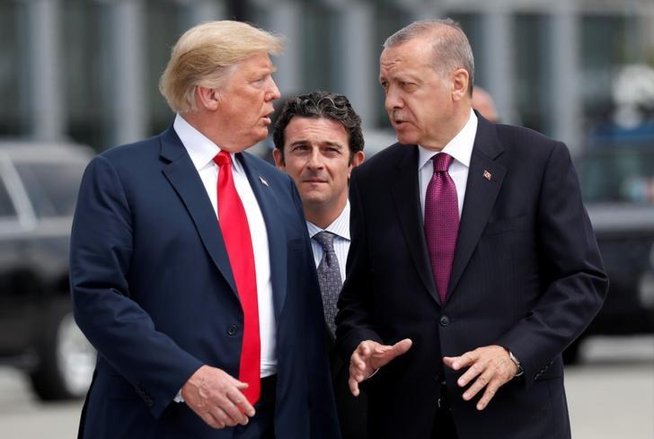 © Reuters.  DETAY HABER-Erdoğan'ın haftasonu Fransa seyahatinde Trump ile görüşmesi bekleniyor; Halkbank, Suriye'deki gelişmeler masada olacak