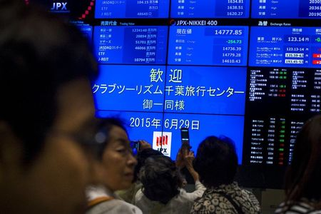 Nikkei ekes out gains, within whisker of erasing pandemic loss