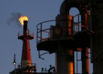 UPDATE 10-U.S. crude jumps on stock draw; Brent slips ahead of OPEC meet
