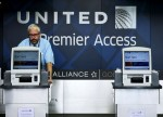 Tesla, Travelers Rise Premarket; United Airlines Falls