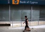 Listing in London, Bank of Cyprus CEO expects modest profitability