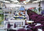India's industrial output growth hits 5-month high of 7 pct in June