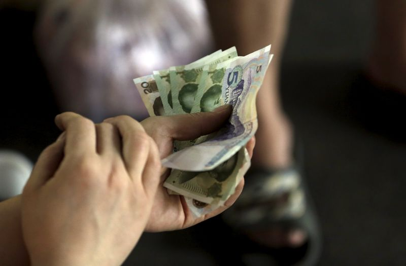 EM ASIA FX-Yuan slightly weaker; Thai baht advances