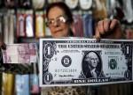 Dólar tem leves oscilações ante real de olho em exterior