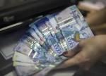 Empresários cazaques defendem contenção da volatilidade do tenge