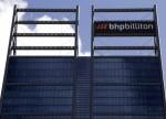 UPDATE 4-Rising costs, trade worries tarnish BHP profit jump, record dividend