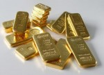 PRECIOUS-Gold shines as trade war fears rattle markets