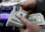 Dollar turns positive but remains under pressure