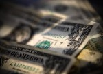 Forex - U.S. Dollar Rises as Consumer Optimism Falls