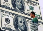 Dollar steadies after downbeat U.S. May factory orders data