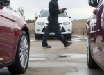 UK car insurance premiums see biggest quarterly fall in four years - survey