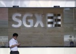UPDATE 1-Singapore Exchange postpones launch of Indian derivatives products