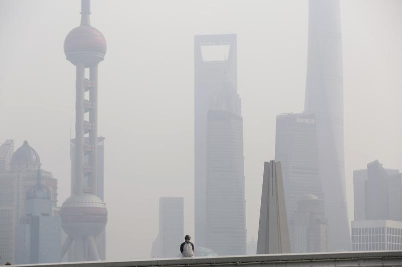 © Reuters.  Shanghai-owned state firms to boost investments in next five years: city government
