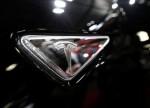 Tesla says starts delivering Shanghai-made Model Y in China