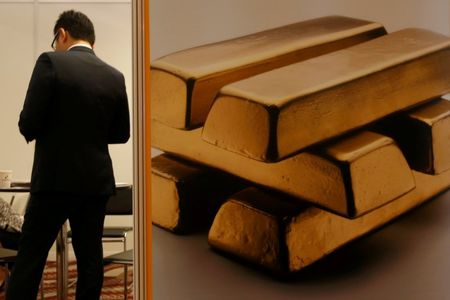 PRECIOUS-Gold subdued as solid U.S. jobs data lifts risk sentiment