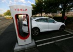Tesla, Otis Rise Premarket; Albertsons Falls